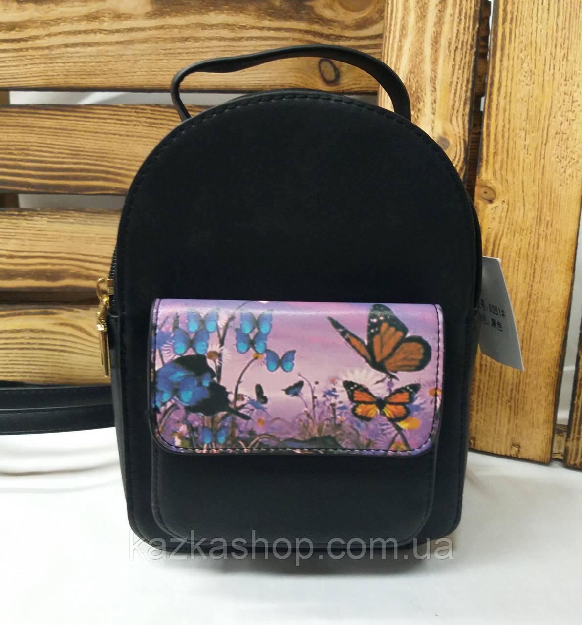 Женский рюкзак черного цвета с ярким дополнительным карманом регулируемыми лямками