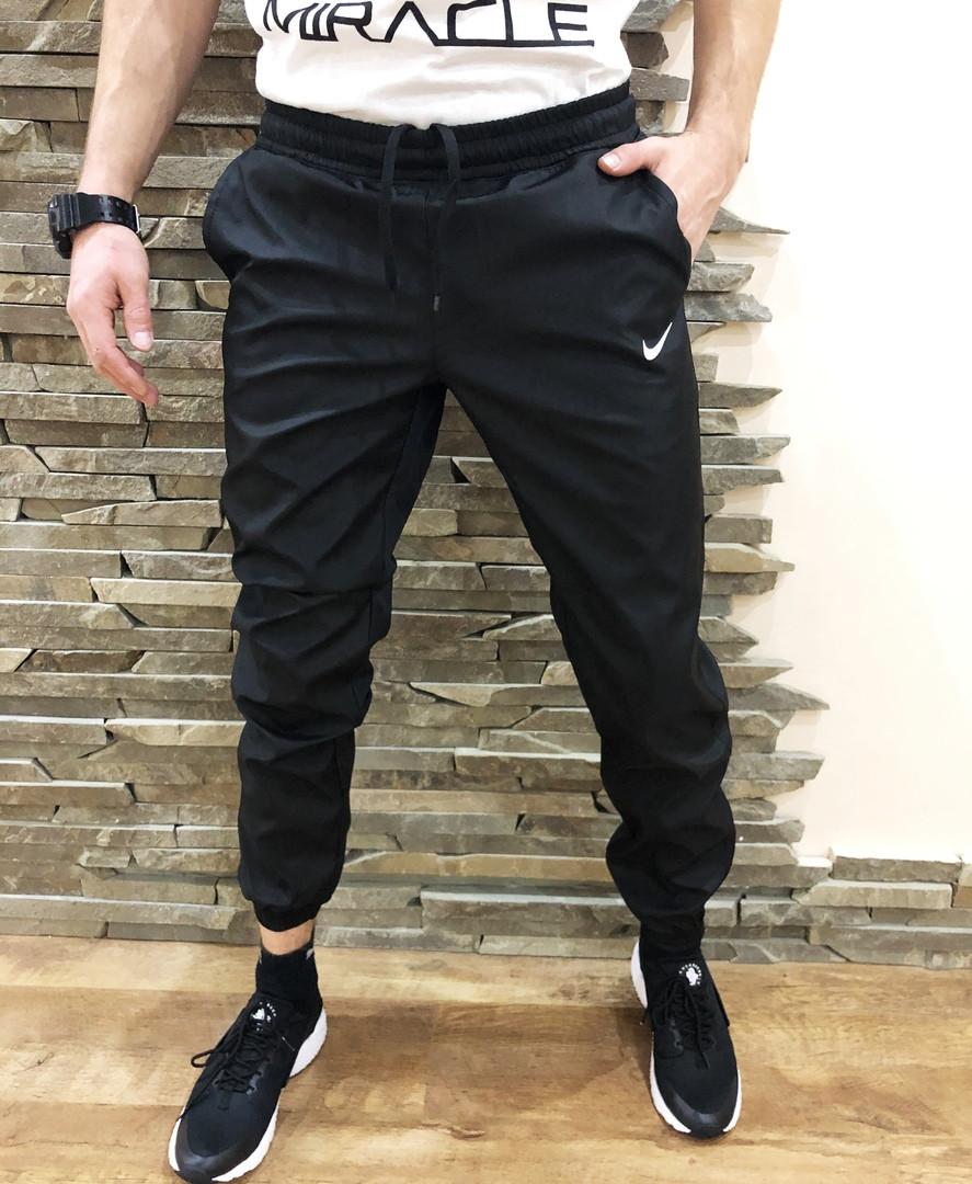 aed89bf5 Купить Мужские спортивные штаны Nike весенние чёрные с плащевки по ...