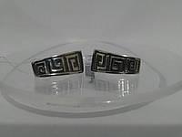 Красивые серебряные серьги с узором