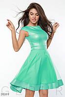 Нарядное платье с расклешенной юбкой зеленое