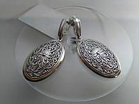 Красивые серебряные серьги без камней длинные