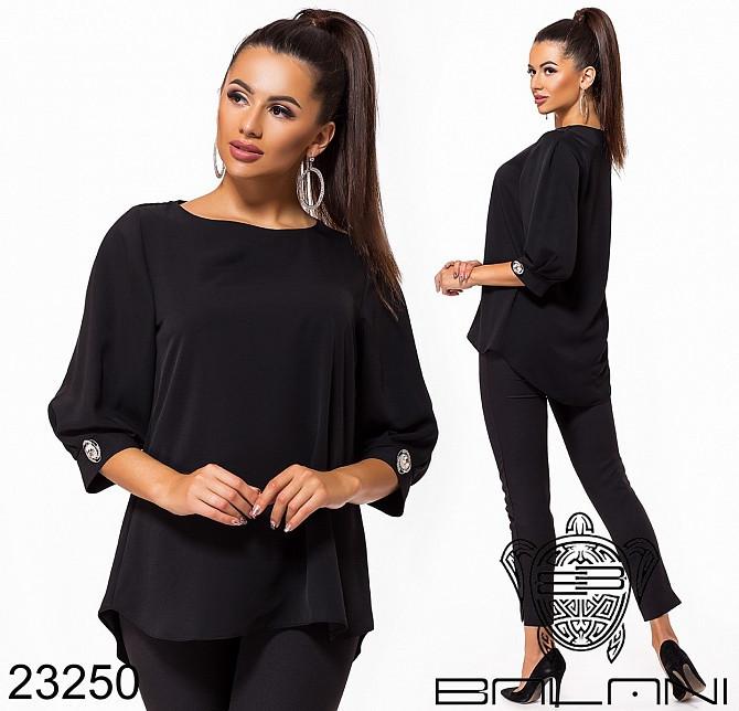 Жіноча вільна блуза з тканини твіл