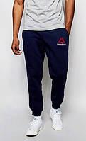 Мужские спортивные штаны Reebok темно синие с манжетами