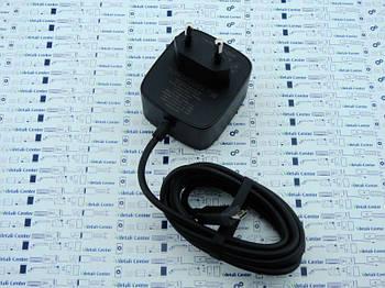 New. Блок питания с кабелем Micro USB для Motorola SPN5890C.