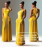 Красивое летнее платье с широкой юбкой в пол, с большими карманами и верхом, украшенным крупными бусинами и ле