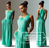 Красивое летнее платье с широкой юбкой в пол, с большими карманами и верхом, украшенным крупными бусинами и лентой завязанной на бант, мятное