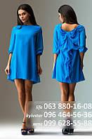 Короткое шифоновое платье с рукавом три четверти, простого сдержанного кроя спереди и оригинальным декором сзади - слегка приоткрыта спина, большй