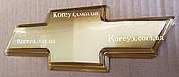 Эмблема решетки радиатора Авео Т-250 крест. Шильдики шевроле купить.