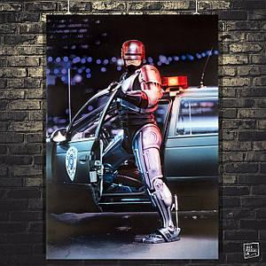 Постер RoboCop, Робокоп, Робот-полицейский у машины. Размер 60x43см (A2). Глянцевая бумага