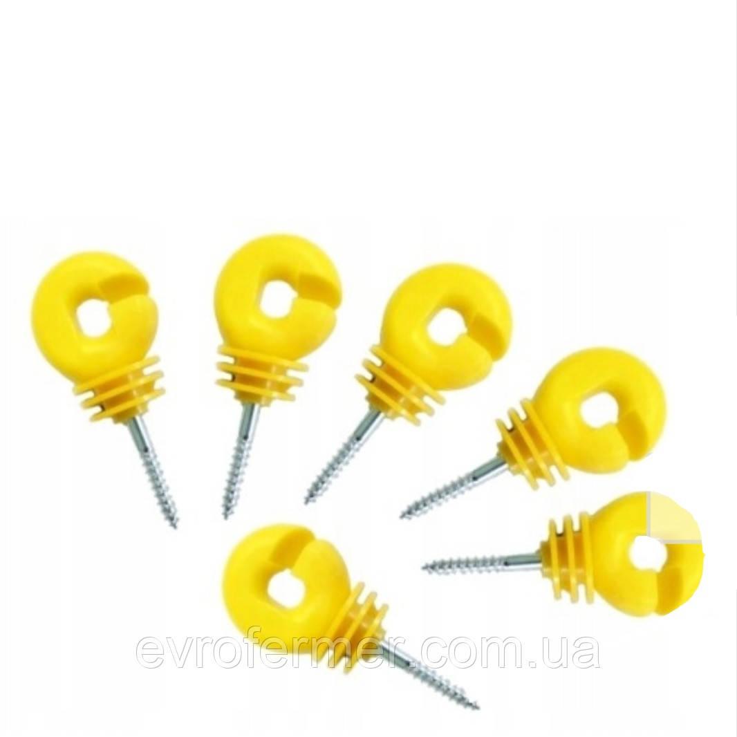 Изоляторы жёлтого цвета под деревянные столбики