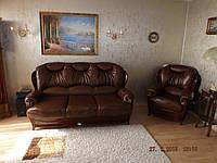 Перетяжка дивана и кресла в кожу