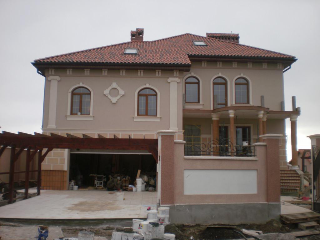 Облицовка и покраска дома по ул. Кораловая