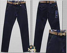 Джинсы-брюки зауженные тёмно-синего цвета с ремнём
