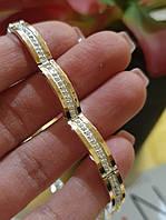 Серебряный браслет с золотыми напайками и маленькими фианитами в центре 254у