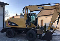 Колёсный экскаватор Caterpillar M313D 2009 года , фото 1