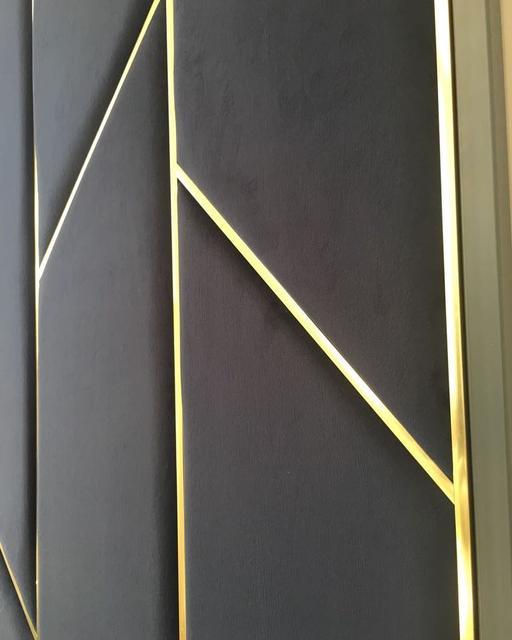 Мягкие стеновые панели с вставками из металла, стекла, дерева.