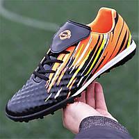 Футзалки, бампы, сороконожки кроссовки для футбола мужские подростковые черные оранжевые (код 7755)
