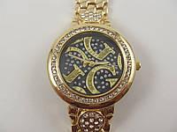 Женские часы Guess 1678 золотистые с черным циферблатом