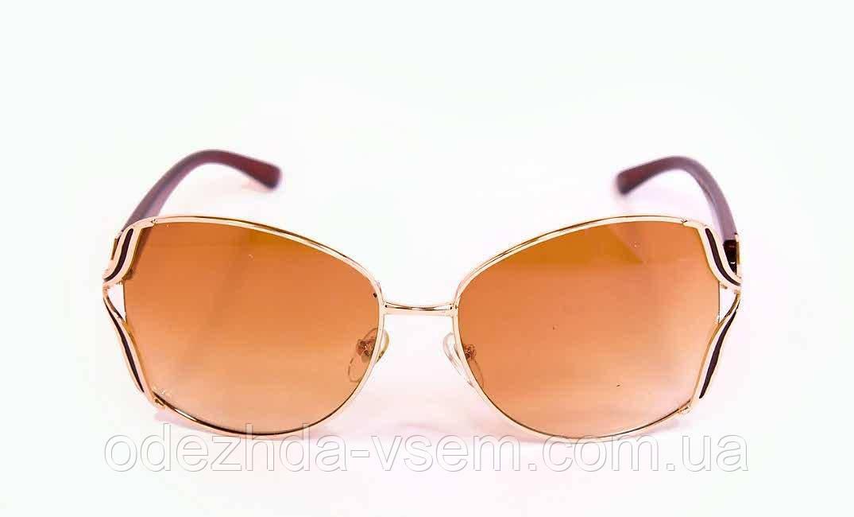 Жіночі окуляри в металевій оправі