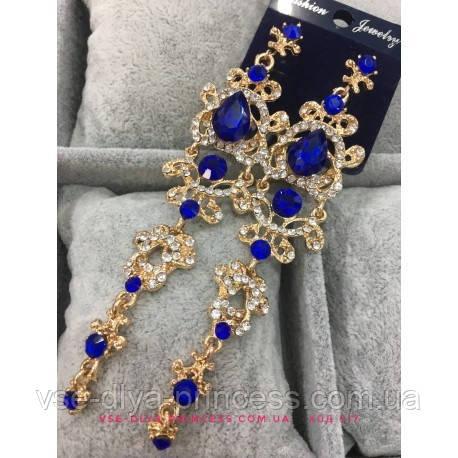 Подовжені вечірні сережки під золото з синіми каменями, висота 12 див.