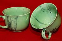 Зеленая чашка-пиала с ручкой.