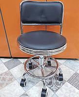 Стул мастера со спинкой на колесиках из кожзама черный