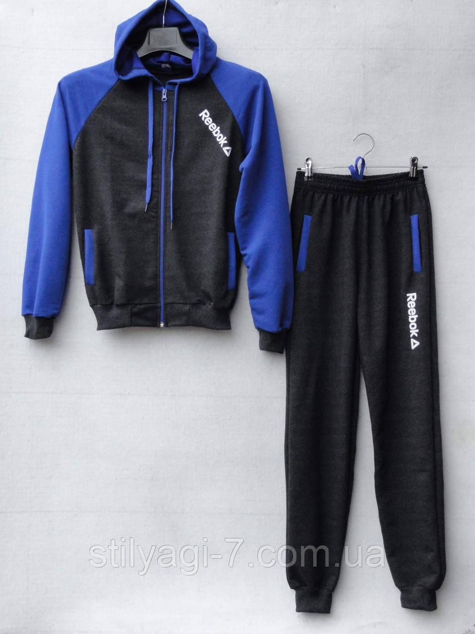 Спортивный костюм для мальчика на 8-12 лет серого с синим цвета c капюшоном Reebok оптом
