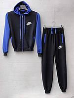 Спортивный костюм для мальчика на 8-12 лет синего цвета c капюшоном Nike оптом
