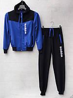 Спортивный костюм для мальчика на 8-12 лет черного c синим цвета c капюшоном Adidas оптом