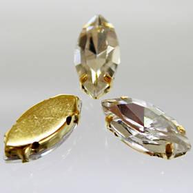 Камни в золотых цапах