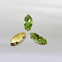 Cтразы в золотых цапах.Лодочка 7х15мм.Цвет Peridot