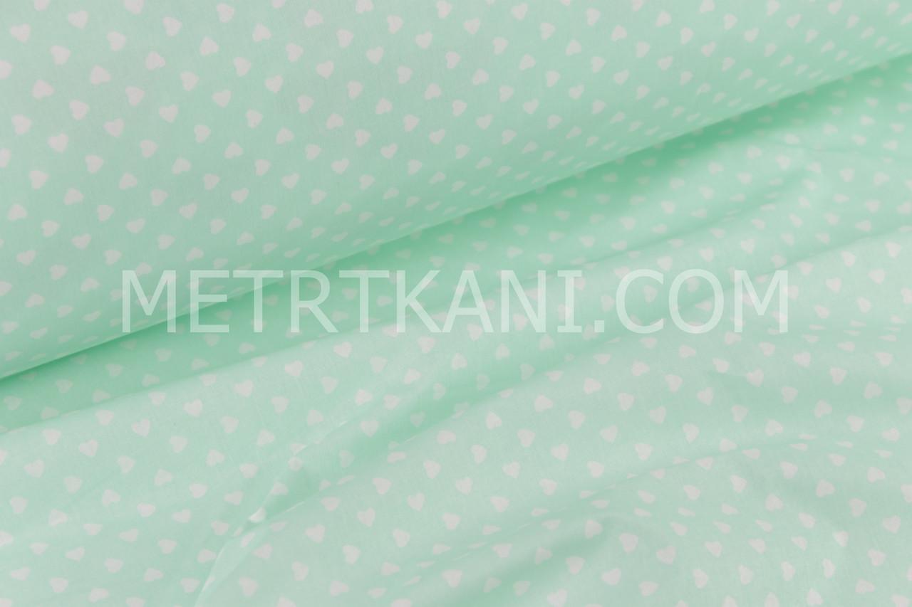 Ткань хлопковая с маленькими сердечками 6 мм мятно-салатовом  фоне №1411