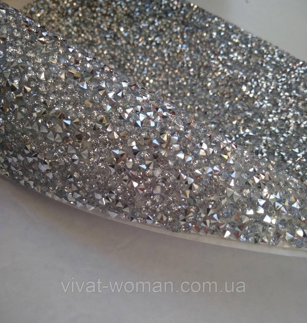 Страхова самоклеюча тканина Silver. Конусні стрази. Ціна за відріз 1х23,5 см