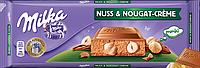 Шоколад Milka Nuss & Nougat - Сreme