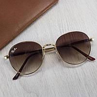 Сонцезахисні окуляри коричневі тішейди