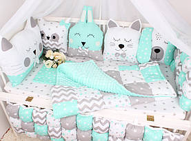 Комплект в ліжечко з тваринками в ніжно М'ятних тонах