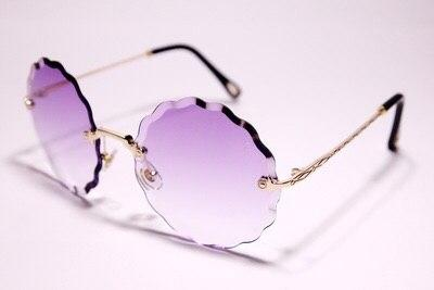 Солнцезащитные очки Chloe круглые розовые