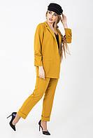 Стильный деловой женский костюм горчичного цвета