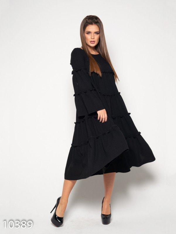 Черное платье-трапеция с воланами и рюшами