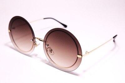 Солнцезащитные очки Chanel круглые коричневые золотистый ободок