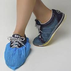 Одноразовий одяг і взуття