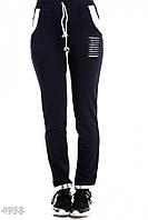 Синие спортивные штаны с отделкой из кожи-металлик и прорезями