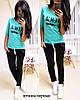 Костюм женский стильный футболка с надписью Vogue и молнией и штаны с декоративными разрезами Dtk1417