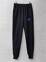 Спортивные штаны для мальчика на 12-16 лет синего, черного цвета Nike оптом