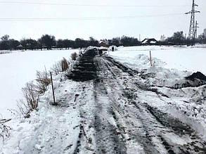 Подготовительные работы на земельном участке. Расчистка от снега, утрамбовка.