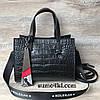 женская кожаная сумка под крокодила