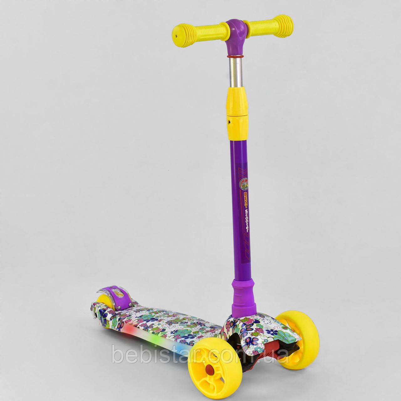 Трехколесный самокат фиолетовый четыре колеса с подсветкой платформы и светящимися колесами деткам от 3 лет
