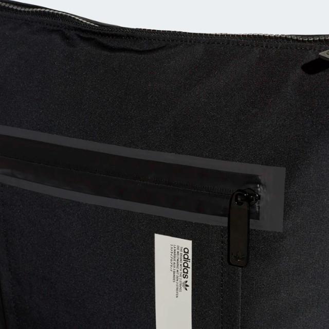 Городской рюкзак ADIDAS NMD SMALL | цвет черный. Фото кармана с лицевой стороны.