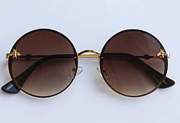 Солнцезащитные очки круглые Гуччи