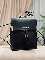 Женский рюкзак-сумка в стиле Michael Kors черного цвета с кисточками из экокожи